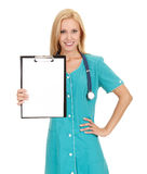 Woman doctor showing clipboard Royalty Free Stock Image