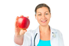 Woman Doctor shows a red apple Stock Photography