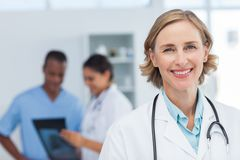 Woman doctor smiling and looking to the camera Royalty Free Stock Photography
