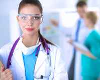 Woman doctor standing with folder at hospital Royalty Free Stock Images