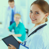 Woman doctor standing at hospital witih folder Royalty Free Stock Photography