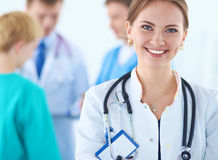Woman doctor standing with stethoscope at hospital Royalty Free Stock Photography
