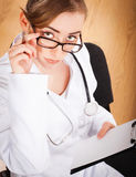 Woman doctor with a stethoscope. Stock Photography