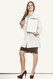 Woman doctor with stethoscope, clipboard and pen. Stock Photos