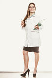Woman doctor with stethoscope, clipboard and pen. Stock Images