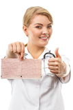 Woman doctor with stethoscope holding electrocardiogram graph, healthcare concept Stock Photos