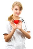 Woman doctor with stethoscope holding red heart, healthcare concept Stock Photography