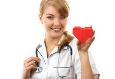 Woman doctor with stethoscope holding red heart, healthcare concept Royalty Free Stock Image