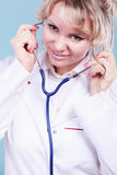 Woman doctor with stethoscope. Medical examinations concept. Doctor pediatrician with stethoscope listening heart beating. Female physician holding professional stock photo