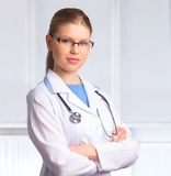 Woman Doctor with stethoscope Royalty Free Stock Image
