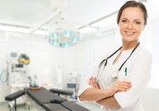 Woman doctor in surgery room Royalty Free Stock Photo