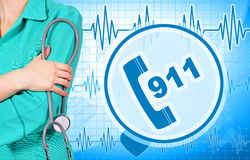 Woman doctor and 911 symbol. On blue  background Royalty Free Stock Photography