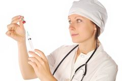 Woman doctor with syringe Royalty Free Stock Photography