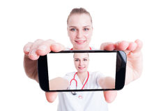 Woman doctor taking a selfie Royalty Free Stock Photography