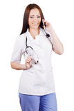Woman doctor talking on a cell phone Royalty Free Stock Image