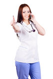 Woman doctor talking on a cell phone Royalty Free Stock Images