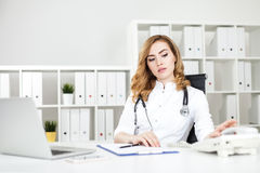 Woman doctor about to call Royalty Free Stock Photo