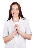 Woman doctor with toothbrush in hand Royalty Free Stock Image