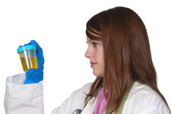 Woman Doctor with Urine Sample. A beautiful young woman doctor holding a urine sample Stock Photography