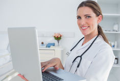 Woman doctor using laptop Stock Images