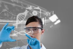Woman doctor watching DNA graphics royalty free stock photo