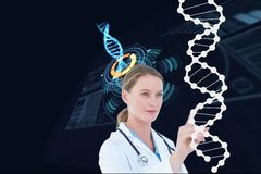 Woman doctor watching DNA graphics stock photos