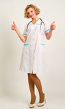 Woman doctor wearing white lab coat holding two thumbs up Royalty Free Stock Images