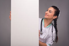 Woman doctor in white smock Royalty Free Stock Photo