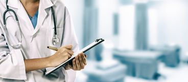 Woman doctor working at the hospital office stock images