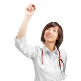 Woman doctor writes something in the air Royalty Free Stock Images