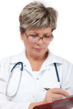 Woman doctor writing a prescription Royalty Free Stock Photos