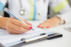 Woman doctor writing Stock Photo