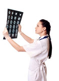 Woman doctor with x-rays of brain Stock Image