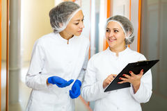 Woman doctors talking about beauty procedures Royalty Free Stock Photos