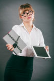 Woman with document and tablet. Digital storage. Royalty Free Stock Photography