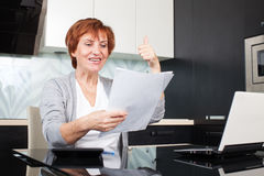 Woman with documents. Happy businesswoman with documentation at home Stock Photography