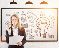 Woman with documents and idea on whiteboard, toned Royalty Free Stock Image