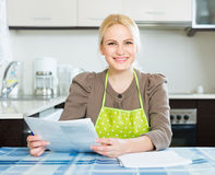 Woman with documents at kitchen Royalty Free Stock Photography