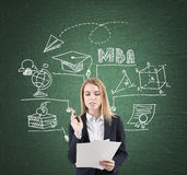 Woman with documents and MBA sketch, blackboard Royalty Free Stock Photos