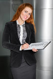 Woman with documents and pen smiling Royalty Free Stock Photo