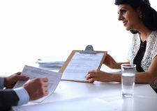 Woman with documents sitting on the desk Royalty Free Stock Image