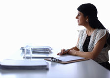 Woman with documents sitting on the desk Royalty Free Stock Photography