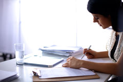 Woman with documents sitting on the desk Stock Image