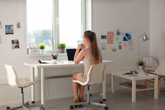 Woman with documents sitting on the desk and Royalty Free Stock Images