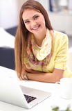 Woman with documents sitting on the desk Stock Photos