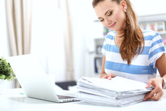 Woman with documents sitting on the desk Stock Photography