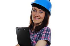 Woman with documents wearing protective blue helmet Stock Image