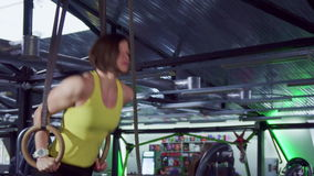 Woman does dips on the rings stock video footage