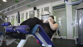 Woman does exercise under supervision stock footage