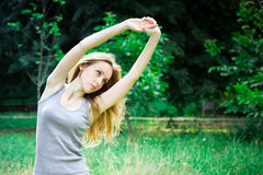 Woman does exercises Royalty Free Stock Photography